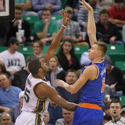 New York Knicks forward Kristaps Porzingis (6) shoots over Utah Jazz forward Derrick Favors (15) as the Utah Jazz play the New York Knicks in NBA basketball action Wednesday, Dec. 9, 2015, in Salt Lake City.