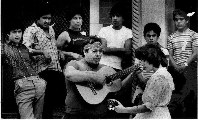 Jesus Negrete and Teresita Delatorre led songs as mourners gathered at Farragut High School in 1983 to honor slain activist Rudy Lozano.