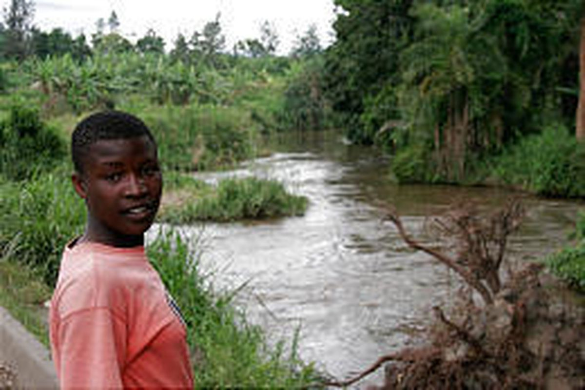 A villager stands near the Rutshuru river that was once the site of a large hippopotamus population, situated at the Virunga National Park close to the town of Rutshuru, Democratic Republic of Congo.