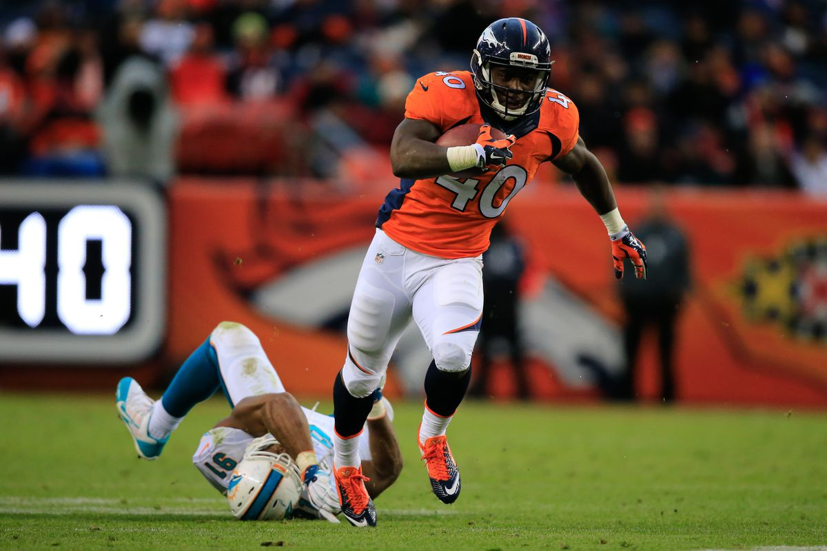Broncos RB Juwan Thompson running for a big gain after breaking a Cam Wake tackle attempt
