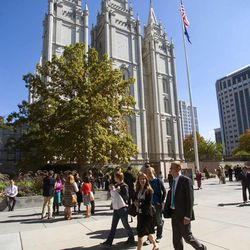 Conference goers walk around Temple Square during the Saturday afternoon session of the 183rd Semiannual General Conference for the Church of Jesus Christ of Latter-day Saints Saturday, Oct. 5, 2013 inside the Conference Center.
