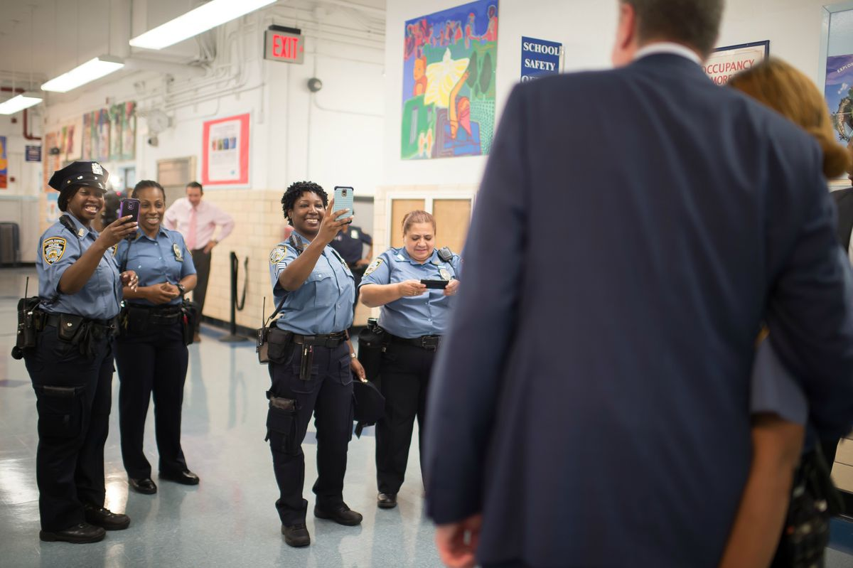 Mayor Bill de Blasio (right) has said that schools can suspend and arrest fewer students, while still maintaining safety and order.