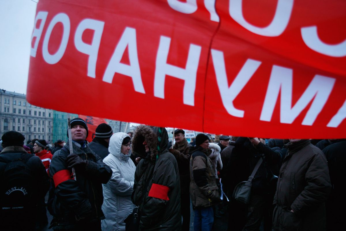 A member of Russia's Communist Party holds a banner during protests in Bolotnaya Square on December 10, 2011, in Moscow, Russia.