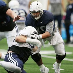 Brigham Young Cougars offensive lineman Jacob Jimenez (70) blocks during an intersquad scrimmage in Provo on Friday, March 23, 2018.