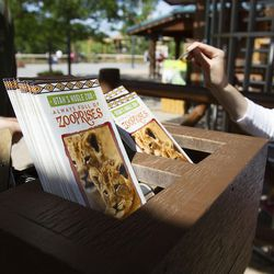 """""""Zooprise"""" pamphlets are seen at Hogle Zoo in Salt Lake City on Tuesday, June 7, 2016. Zoo officials had a """"zooprise"""" when Zeya, an Amur leopard, briefly escaped from her enclosure on Tuesday."""