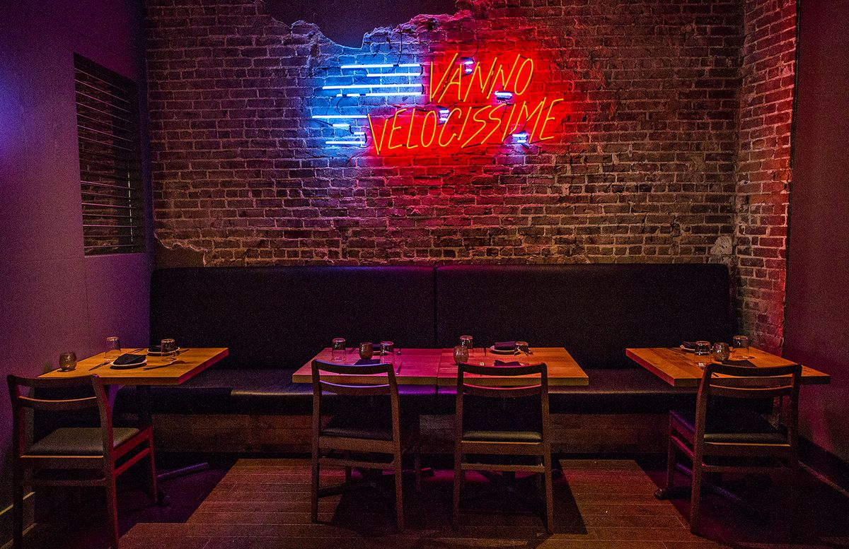 More neon and brick creates a clubby atmosphere.
