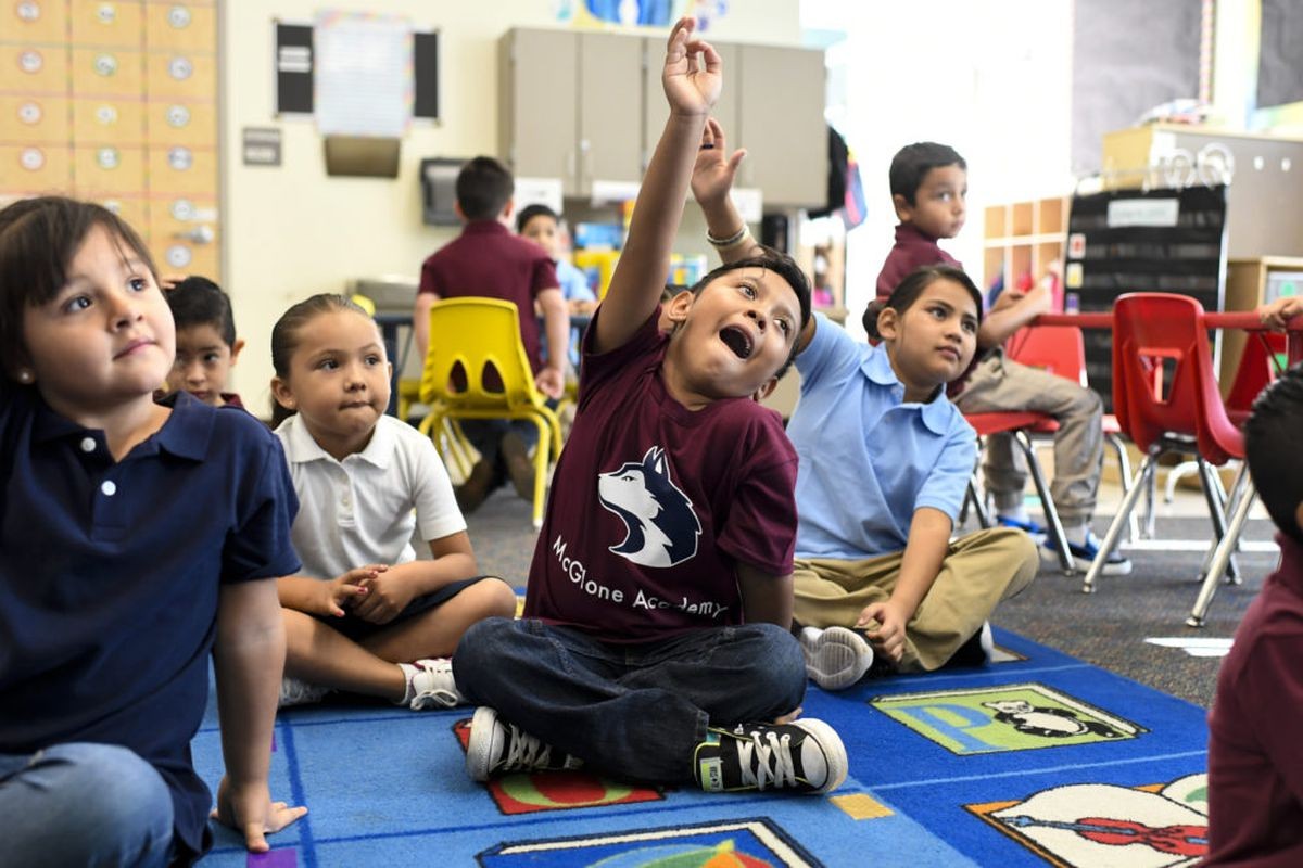 Ismael Mora raises his hand on the first day of school at McGlone Academy in Denver on Aug. 15, 2018.