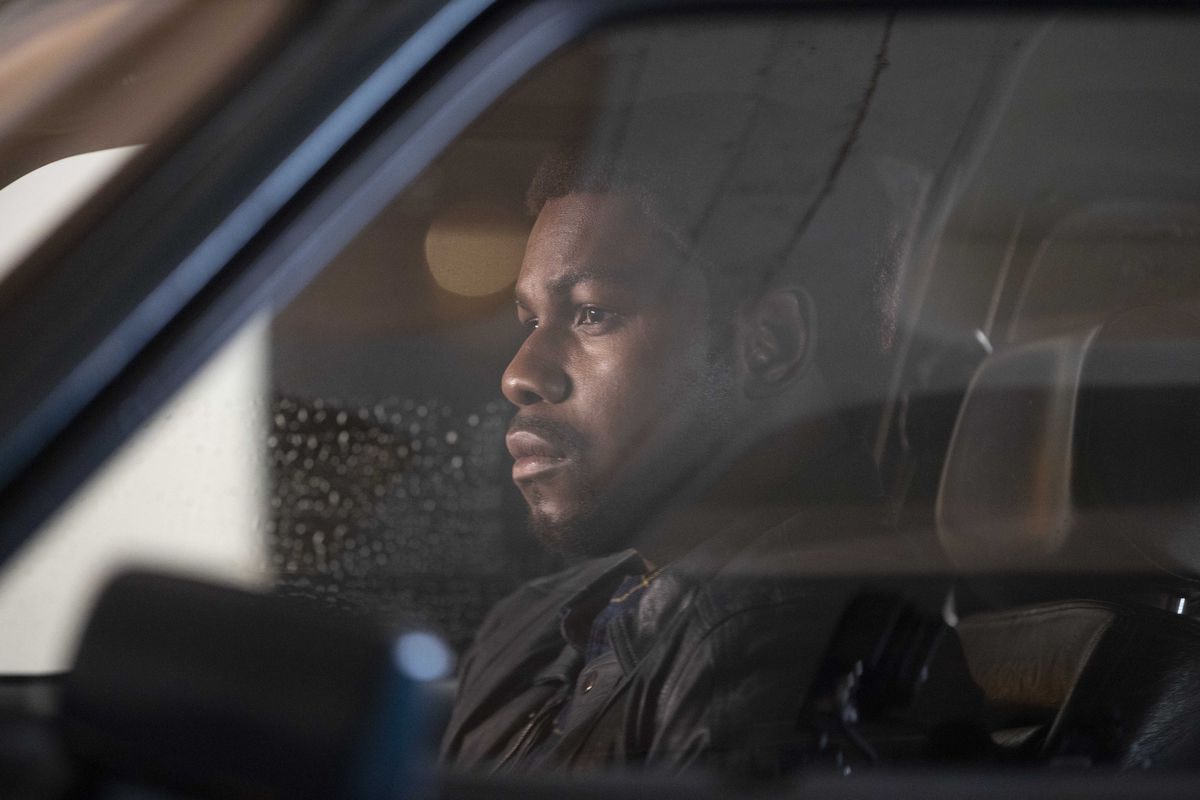 John Boyega sits in his car in Small Axe: Red, White and Blue
