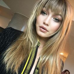 """Gigi Hadid's hairstylist gives us a look at the amazing """"fringe"""" that he cut before the show. The jury is still out on if it's the real deal."""