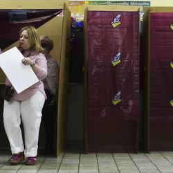 A woman votes during the fifth referendum in San Juan, Puerto Rico, Sunday, June 11, 2017. Puerto Ricans are getting the chance to tell U.S. Congress on Sunday which political status they believe best benefits the U.S. territory as it remains mired in a deep economic crisis that has triggered an exodus of islanders to the U.S mainland. Congress ultimately has to approve the outcome of Sunday's referendum that offers voters three choices: statehood, free association/independence or current territorial status.