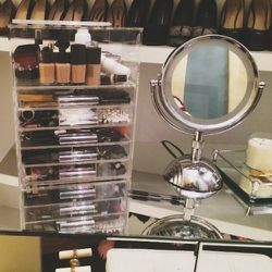 """I just got this makeup organizer called the """"icebox."""" It's the best thing because now my dressing table is neat and clean with all my makeup tucked away."""
