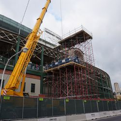 The scaffolding and crane on Addison Street, just east of the marquee, to hold dumpsters