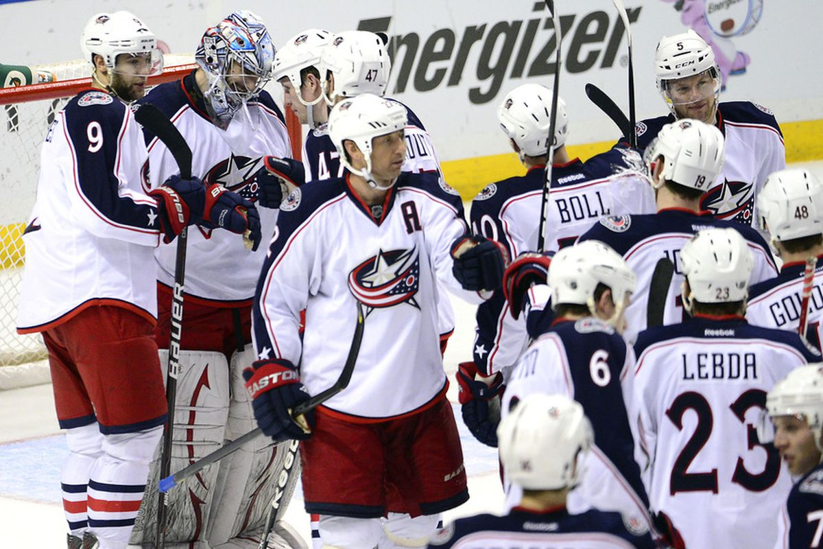 Mar 31, 2012; St. Louis, MO, USA; Columbus Blue Jackets goalie Allen York (41) is congratulated after the game against the St. Louis Blues at the Scottrade Center. The Blue Jackets defeated the Blues 5-2. Mandatory Credit: Scott Rovak-US PRESSWIRE