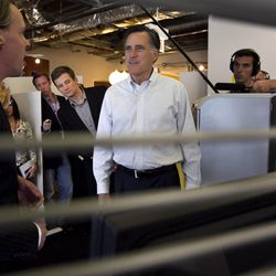 Republican presidential candidate, former Massachusetts Gov. Mitt Romney, center, speaks with Google employee Ted Souder, left, at the Chicago Google headquarters, in Chicago, Tuesday, March 20, 2012. Romney participated in a live-streaming internet discussion during the visit. (AP Photo/Steven Senne)