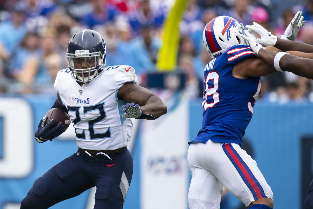 Derrick Henry of the Tennessee Titans runs with the ball during the first half against the Buffalo Bills at Nissan Stadium on October 6, 2019 in Nashville, Tennessee.
