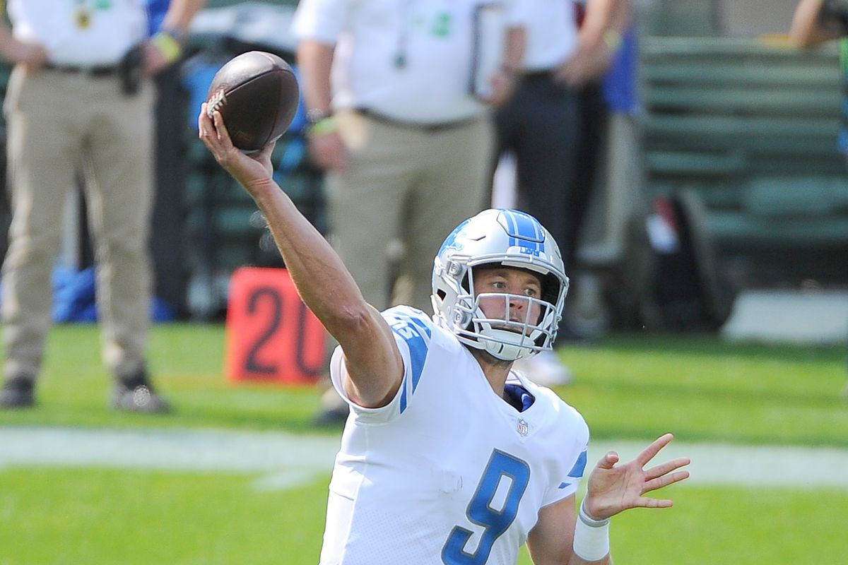 Detroit Lions quarterback Matthew Stafford throws the ball down field agains the Green Bay Packers at Lambeau Field.