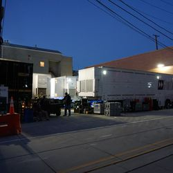 TV production trucks setting up in the broadcast lot, along Waveland Avenue