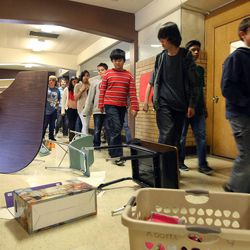 """Vista Elementary students look at """"debris"""" blocking an exit as they participate in an earthquake drill in Taylorsville, Tuesday, April 17, 2012. This was part of the Great Utah ShakeOut."""