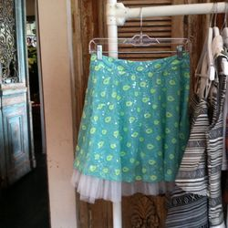 A sequined skirt with a tulle underlay.