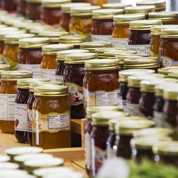 Fruit preserves in jars are lined up for shoppers on the opening day of the farmers market Saturday, June 13, 2015, in Salt Lake City at Pioneer Park.