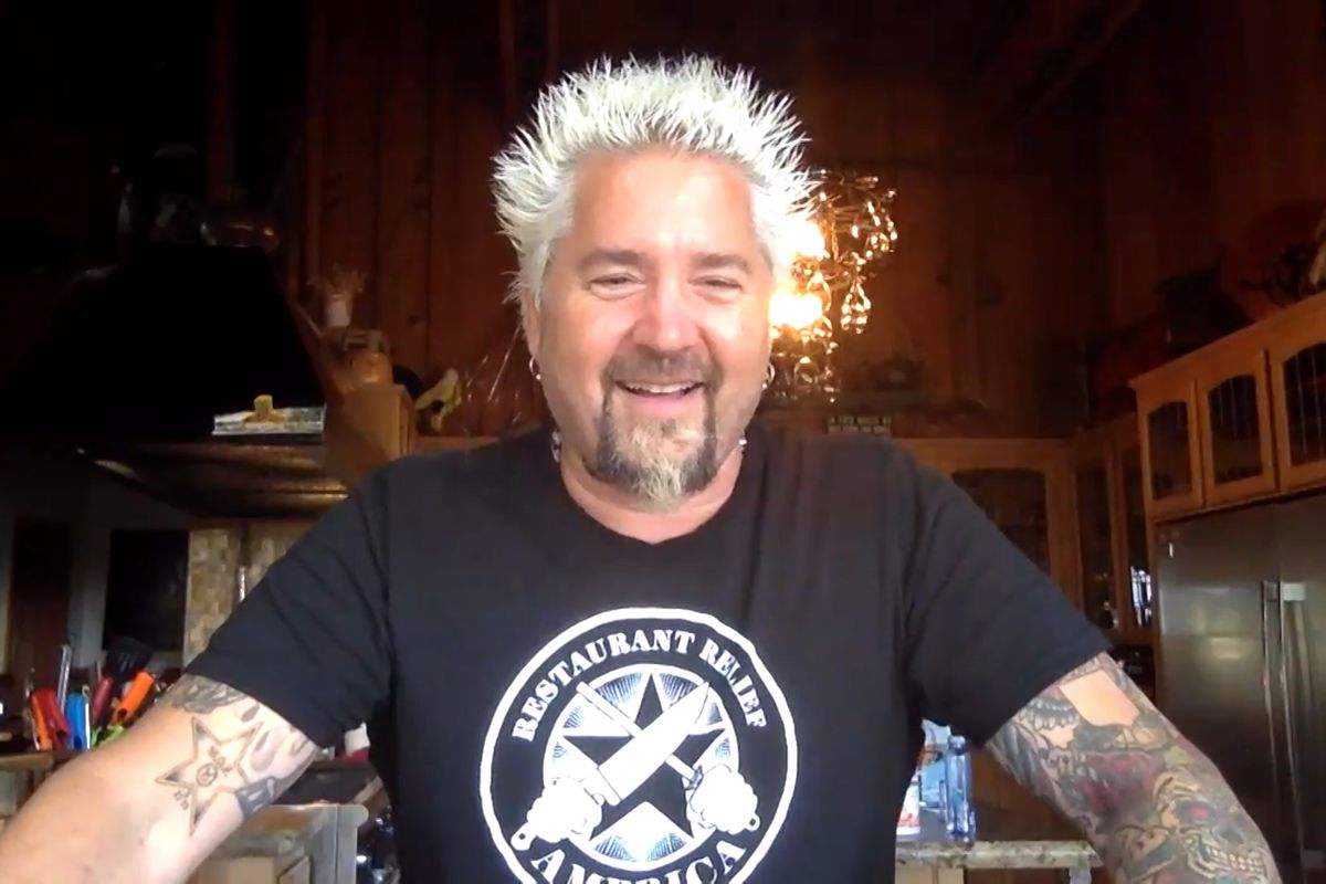 Guy Fieri smiling and wearing a black tshirt