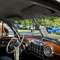 Sue North looks at the interior of a 1941 Cadillac 60 Special during a car show Saturday at Midvale Park in Midvale. The proceeds from the car show were donated to Shriners Hospital.