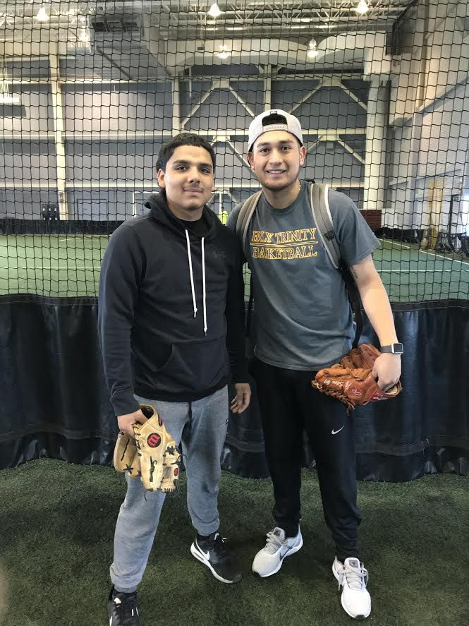 Peak mentee Rafael Garduno, a sophomore at Holy Trinity High School, with mentor Jerry Silva, in August at the YMCA where the two spend time working out and practicing baseball. | Provided/Jerry Silva