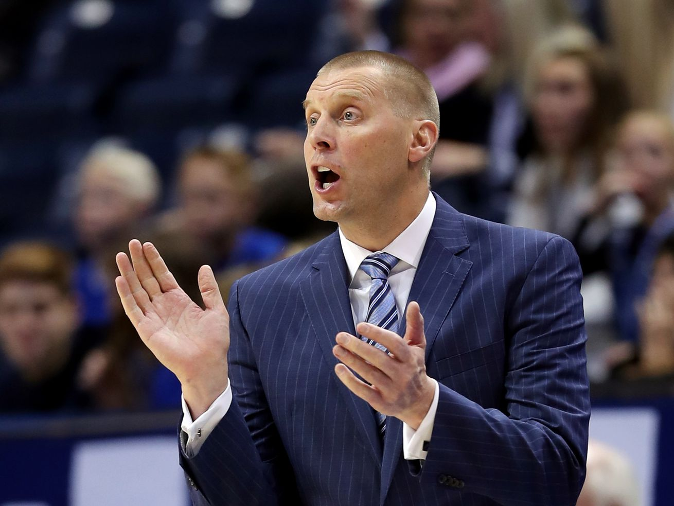 Brigham Young Cougars head coach Mark Pope claps his hands as BYU and Cal State Fullerton play a college basketball game at the Marriott Center in Provo on Tuesday, Nov. 5, 2019.