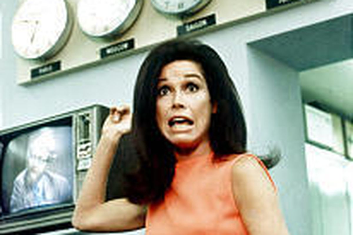 Mary Tyler Moore in the fictional Minneapolis newsroom WJM-TV.