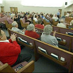 Baptists in West Valley City applaud as Bobby Welch is introduced.