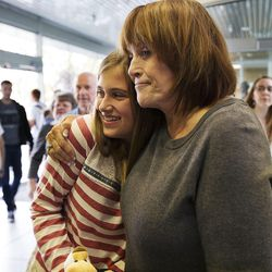 Kira O'Neil, 13, gets a hug from her grandmother, Janet Reynolds as her father, CEO of the Philadelphia 76ers Scott O'Neil visits students of the BYU Marriott School in Provo, Thursday, Oct. 13, 2016.