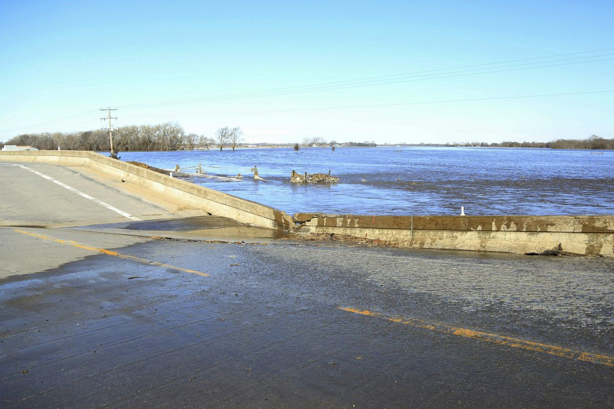 FILE - In this Friday, March 15, 2019 file photo, a bridge brought down by flood waters is seen near Norfolk, Neb. The Associated Press tallied about $1.2 billion of damage in 24 states based on preliminary assessments of public infrastructure categories