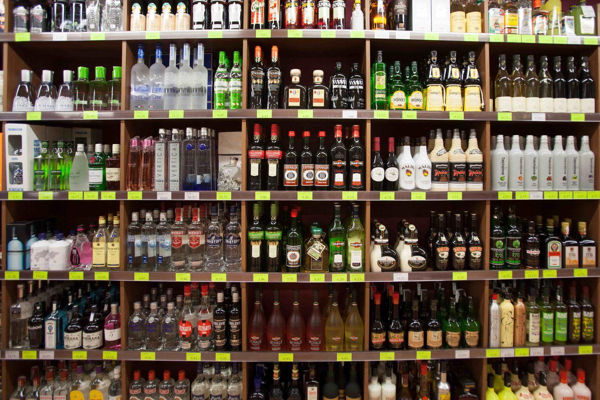 shelves holding bottles of alcohol