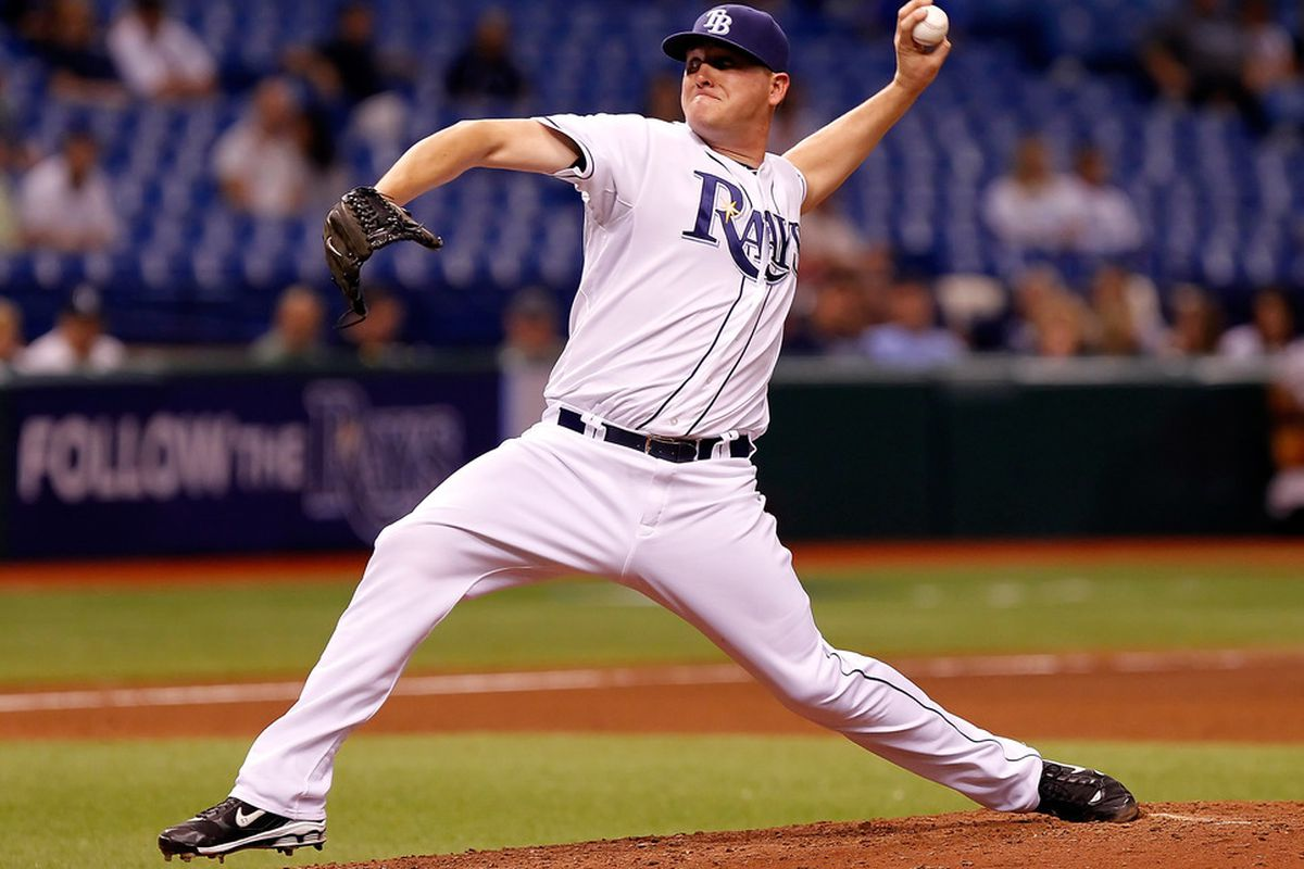 ST. PETERSBURG, FL - SEPTEMBER 06:  Pitcher Jake McGee #57 of the Tampa Bay Rays pitches against the Texas Rangers during the game at Tropicana Field on September 6, 2011 in St. Petersburg, Florida.  (Photo by J. Meric/Getty Images)