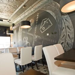 The downstairs dining room has a chalkboard wall and seats about 50