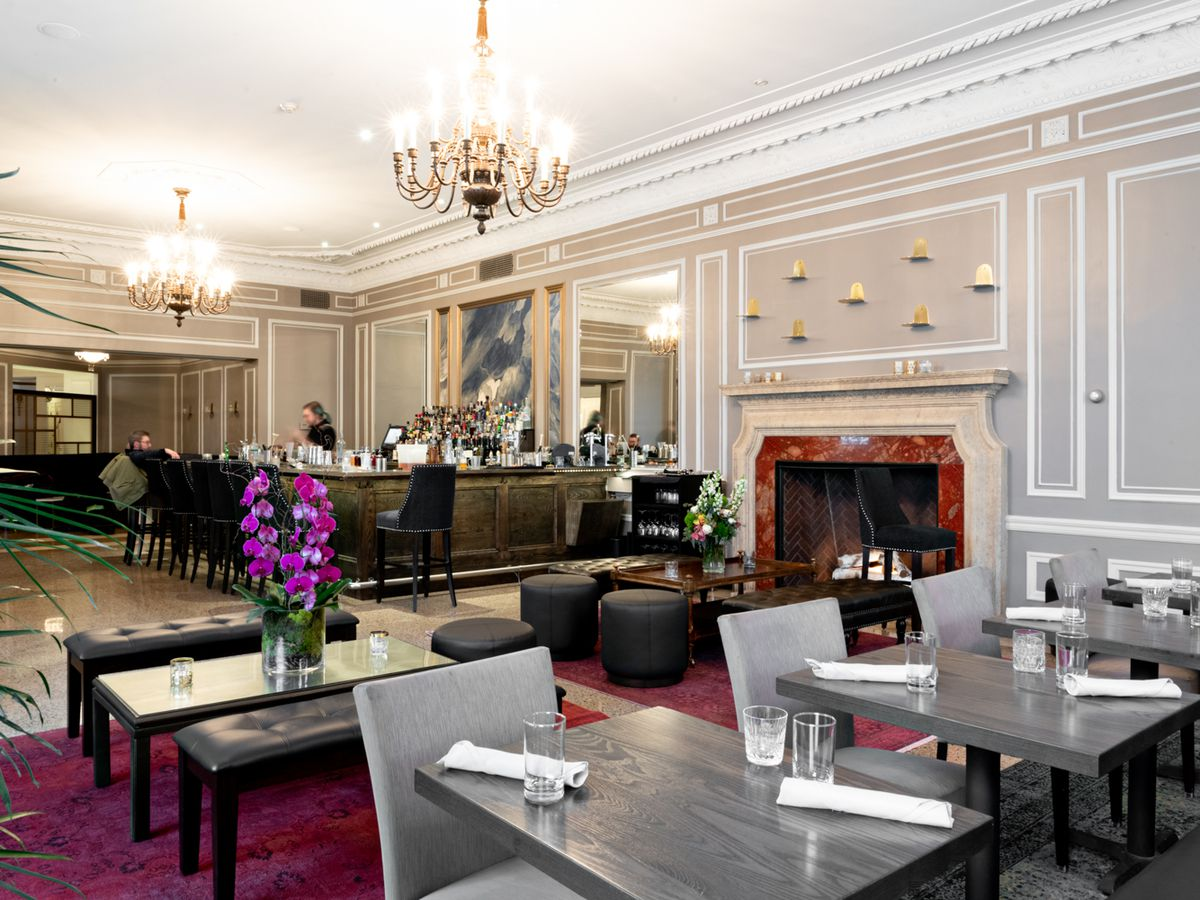 The marble accented Lounge at PS Steak, with a beautiful fire place and cream colored walls