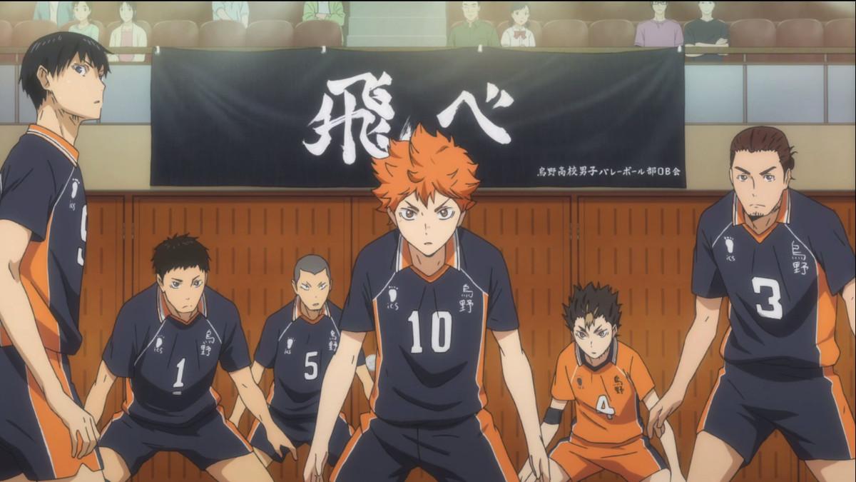 the karasuno boy's volleyball team getting ready to score