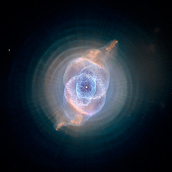 """<a href""""http://hubblesite.org/newscenter/archive/releases/2004/27/image/a/"""">The Cat's Eye Nebula (2004)</a>"""