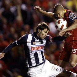 Alvaro Saborio of Real Salt Lake fights for control of the ball against Jose Maria Basanta from the Rayados of Monterrey during the final game of the CONCACAF championship at Rio Tinto Stadium in Sandy Wednesday, April 27, 2011.