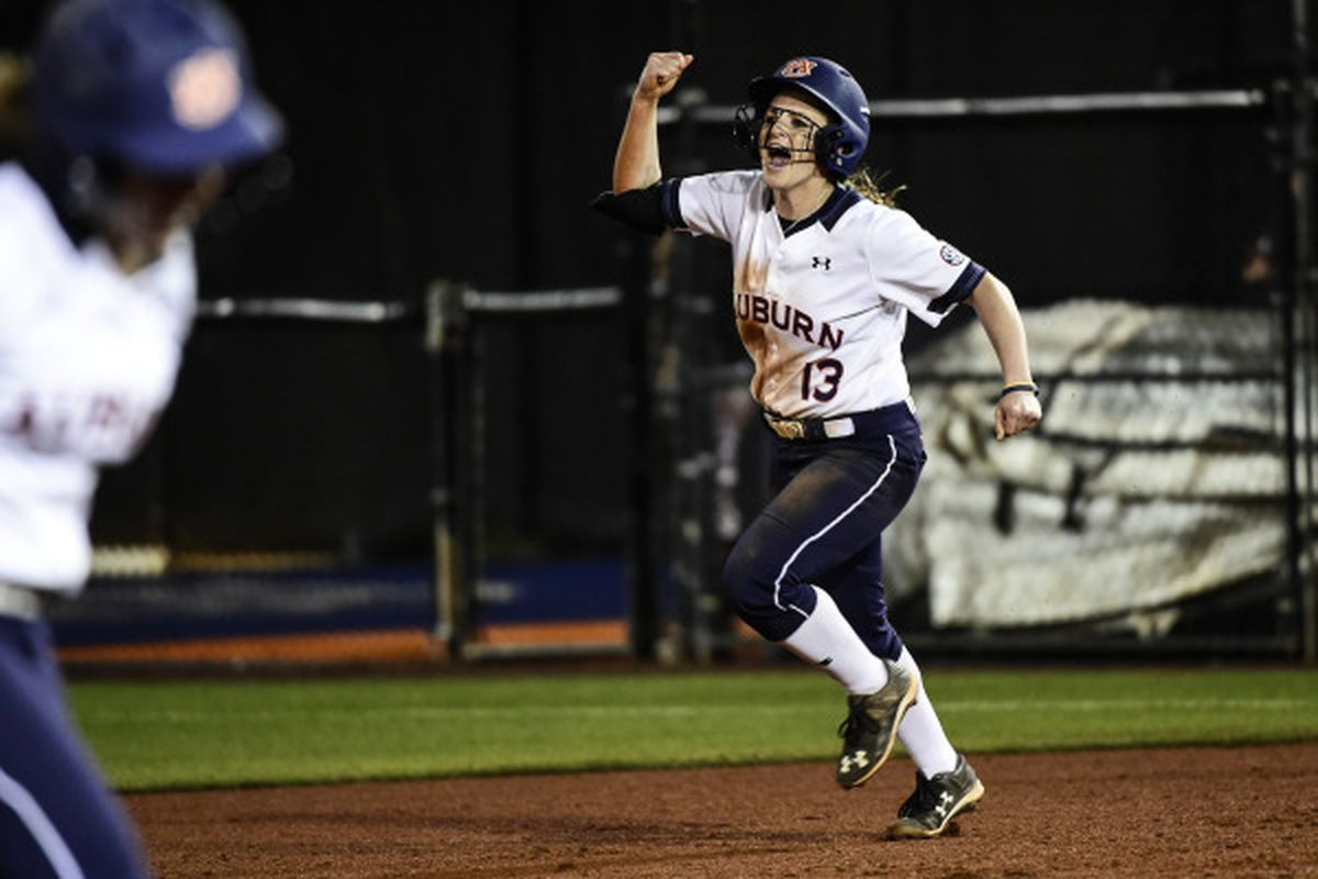 Kasey Cooper rounds the bases after her walk-off home run Friday night.
