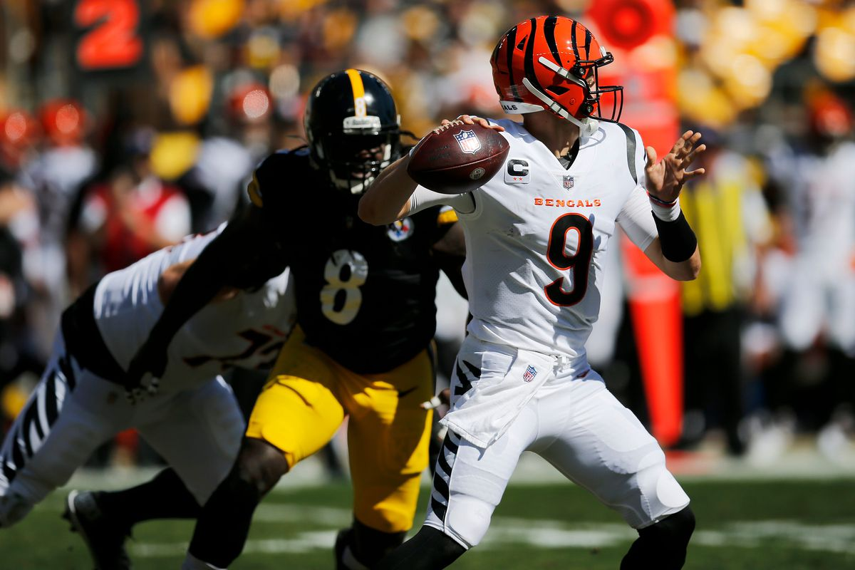 Cincinnati Bengals quarterback Joe Burrow (9) throws under pressure from Pittsburgh Steelers linebacker Melvin Ingram (8) in the second quarter of the NFL Week 3 game between the Pittsburgh Steelers and the Cincinnati Bengals at Heinz Field in Pittsburgh on Sunday, Sept. 26, 2021. The Bengals led 14-7 at halftime.