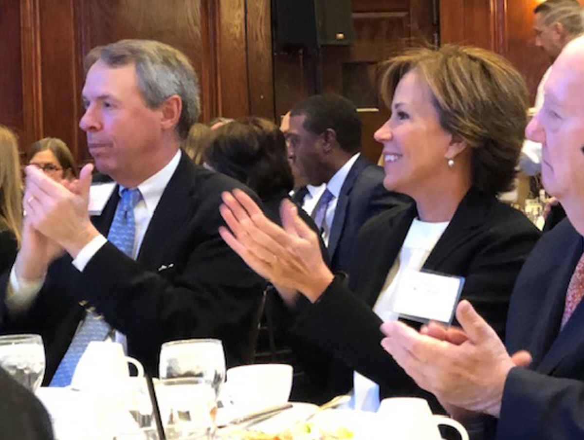 Bill Daley's wife, Bernadette Keller, joins in the applause for her husband as he speaks at a City Club of Chicago luncheon Wednesday. | Fran Spielman/Sun-Times
