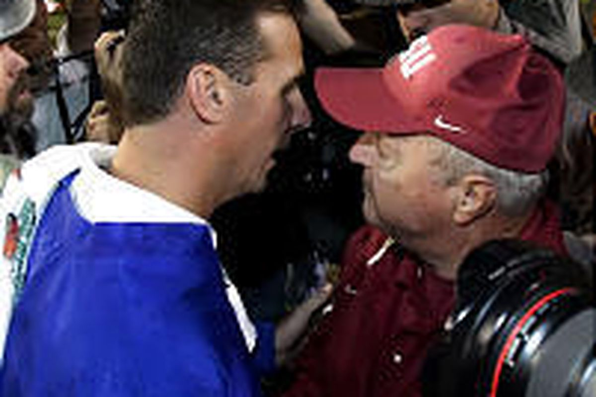 Florida coach Urban Meyer exchanges words with Bobby Bowden after beating Florida State Saturday.