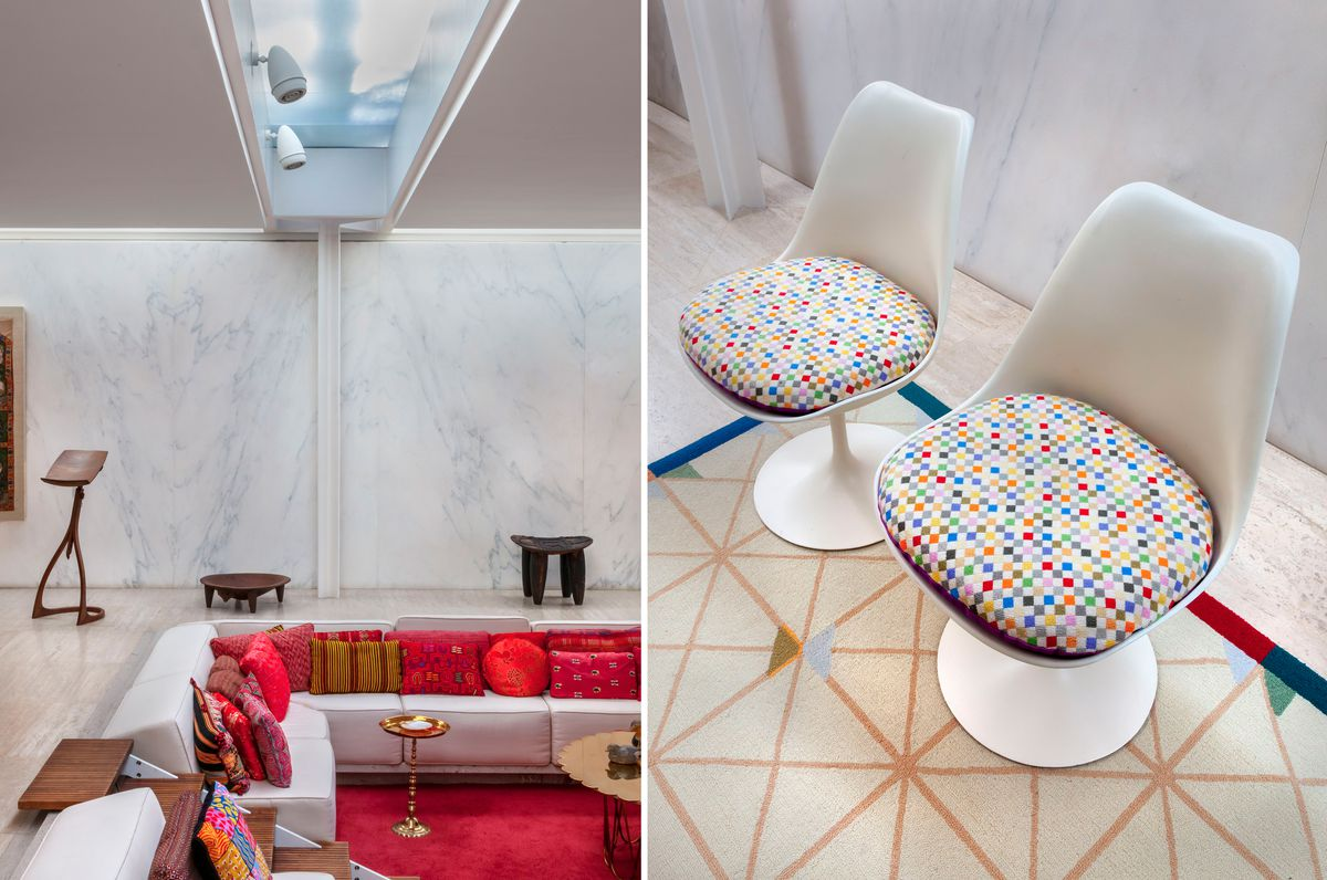 Two images side by side: at left, a close-up view of upholstered banquette seating sunken into the floor of a living room with stone floors, lit by natural daylight from a skylight directly above. At right, a close-up of two white, curvy modern chairs wit
