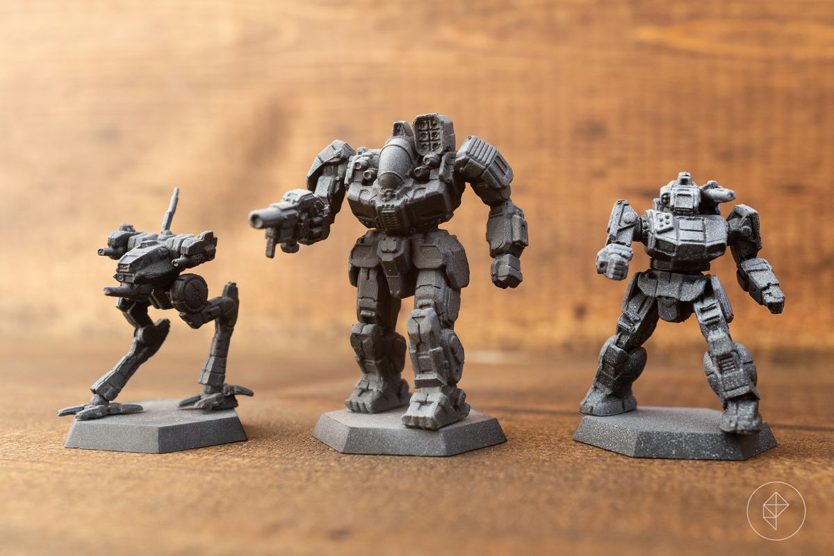 Three pre-shaded, black and white miniatures.