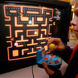 Jake Gautney, 12, of Chappaqua, N.Y., tries a Ms. Pac-Man TV game, which has won praise from Toy Wishes magazine.