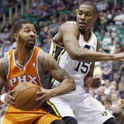 Utah's Derrick Favors defends Phoenix's Markieff Morris as the Utah Jazz and the Phoenix Suns play Wednesday, March 27, 2013 in Energy Solutions arena. Utah wins 103-88.