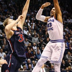 Brigham Young Cougars forward Yoeli Childs (23) sky hooks a shot over Saint Mary's center Jock Landale (34) as the BYU Cougars take on the Saint Mary's Gaels in the Marriott Center in Provo on Saturday, Dec. 30, 2017.