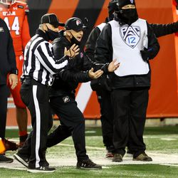 Utah Utes head coach Kyle Whittingham complains to the referee after a call as Utah and Oregon State play a college football game at Rice Eccles stadium in Salt Lake City on Sunday, Dec. 6, 2020. Utah won 30-24.