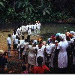 Would-be Latter-day Saints are baptized by the hundreds after the first missionary couples arrive in West Africa following the 1978 revelation on the priesthood.